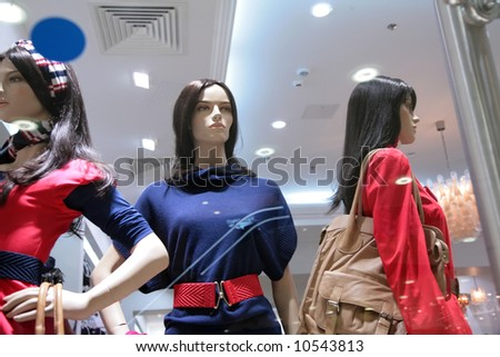 three mannequins in store - stock photo
