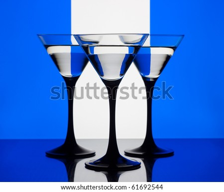 Three martini glass on a blue white and blue background - stock photo