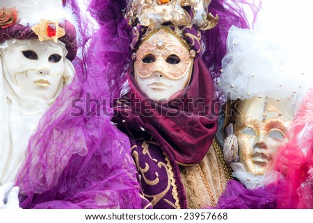 Three  masks in Venice, Italy. Shot with a flou filter to make a dreaming effect. High key image. - stock photo