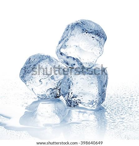 Three melting ice cubes on white background. - stock photo