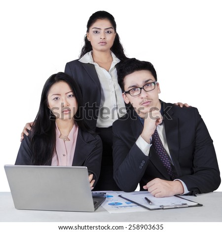 Three member of confident multicultural business team with laptop and paperwork, isolated on white - stock photo