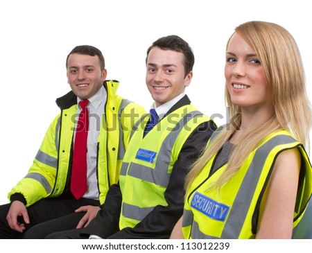three members of a security team sitting down, isolated on white