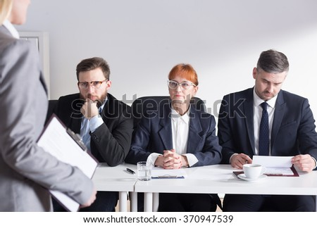 Three members of management during interview with applicant