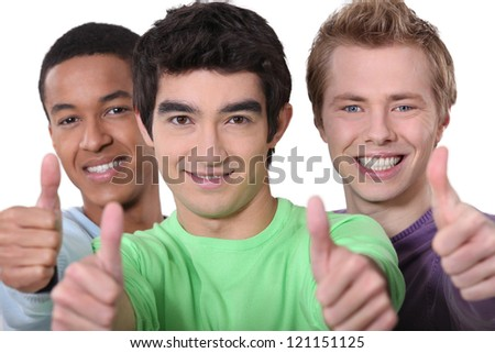 Three men giving thumbs-up sign - stock photo