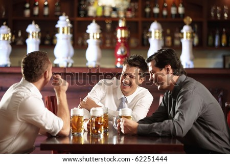 Three men in shirts in the bar - stock photo
