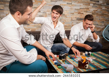 three men playing poker - stock photo