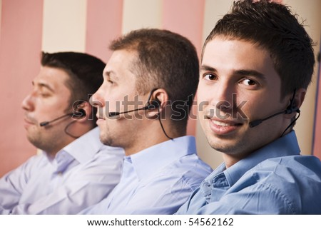 Three men support team working,focus on first man which smiling and looking you - stock photo