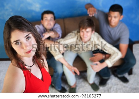 Three men try to reach out for a beautiful young woman - stock photo