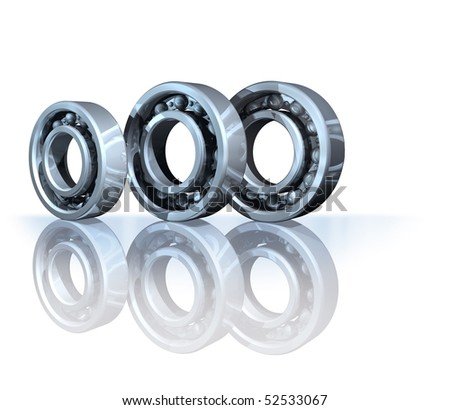 Three metal ball bearings on white reflective background