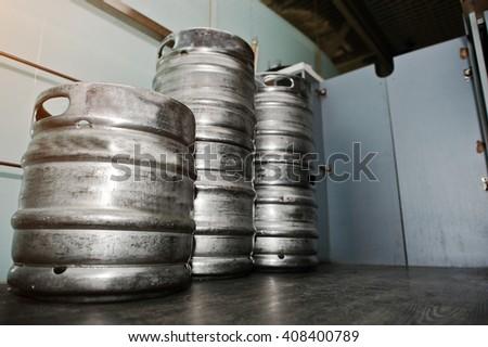 Three metal beer keg barrel - stock photo