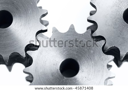 three metal cogs on a white background - stock photo