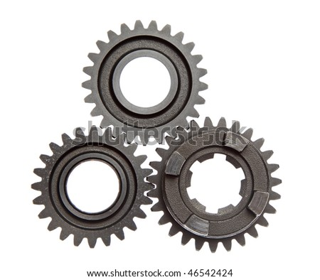 Three metal gears linked together on a white background. - stock photo