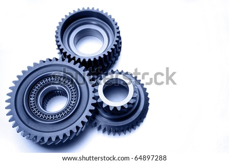 Three metal gears on plain background - stock photo