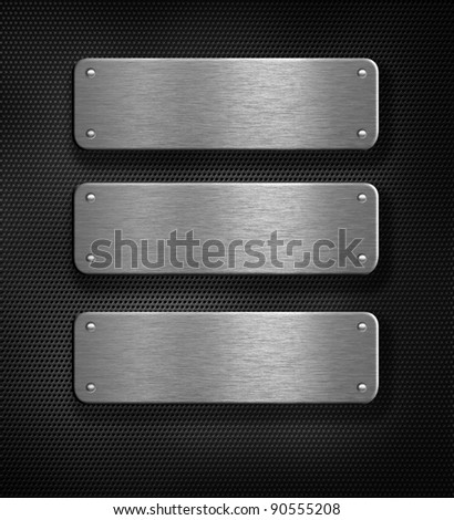 three metal plates over grid background - stock photo
