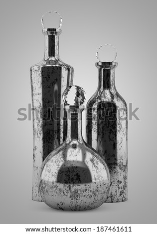 three metallic bottles isolated on gray background