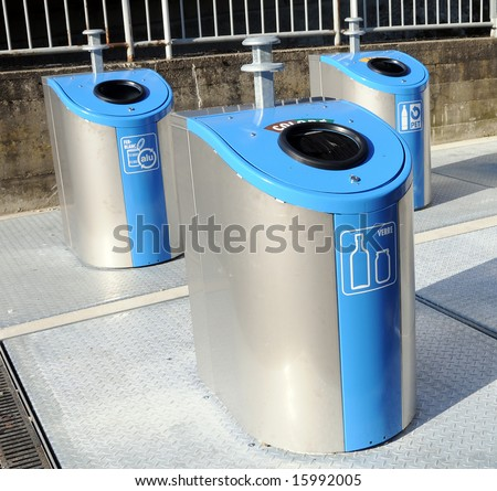 Three metallic trash cans for different garbage - stock photo