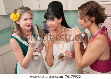 Three middle-aged woman smoke in a retro-style tea party - stock photo