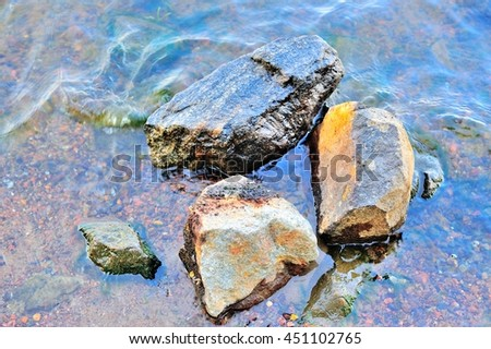Three middle stones in the river