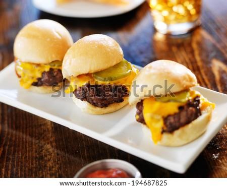 three mini burger sliders in a row - stock photo