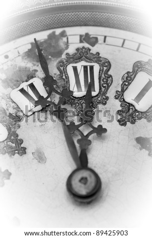 Three minutes before midnight. Vintage clock with arrows. - stock photo
