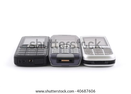 Three mobile phones on white background