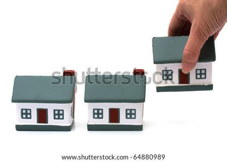 Three model homes isolated on a white background, model house - stock photo