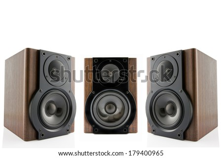 Three modern audio speakers in classic wooden casing isolated on white background