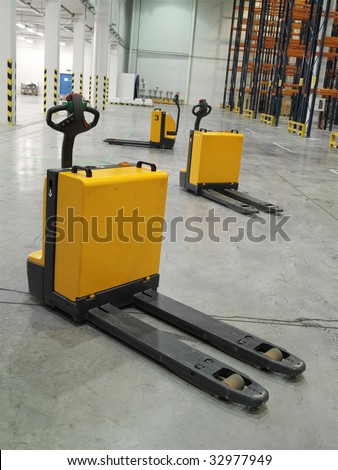 three modern loaders in the empty storehouse