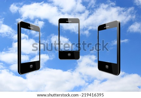 three modern mobile phones on the cloudy sky - stock photo