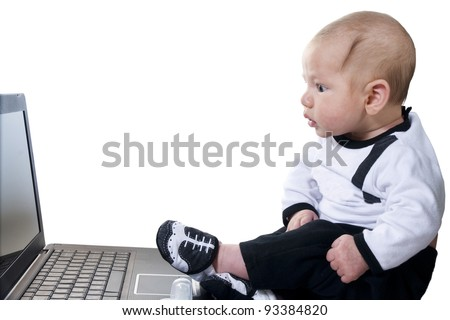 Three-month baby in a suit businessman with amazement looking at computer screen - stock photo
