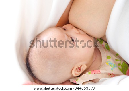 Three months old asian baby drinking breastmilk