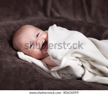 Three months old baby has lot of fun. - stock photo
