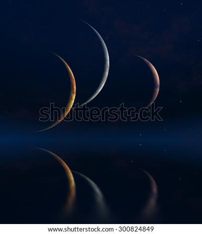 Three moons and Quiet Sea - stock photo