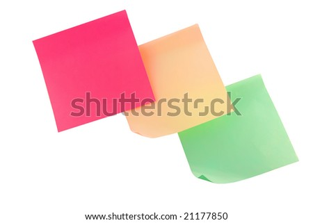 Three multi colored stickers hanging on the wall - stock photo