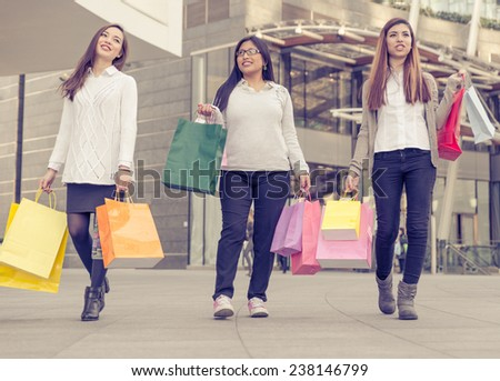 three multi ethnic women making shopping in the center