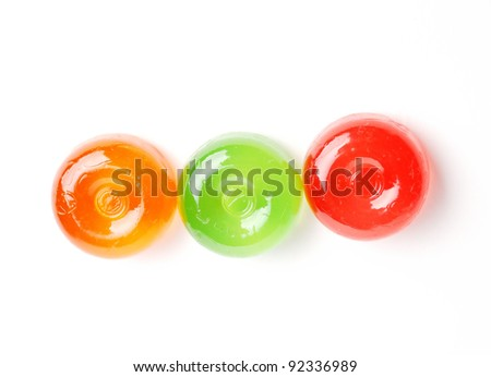 Three multicolored lollypops isolated on white - stock photo