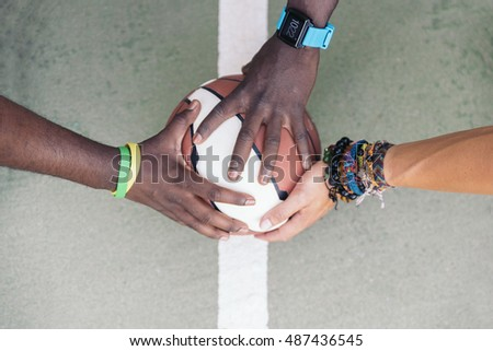 Three Multiethnic Friends Stacking Hands.