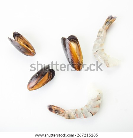 Three mussels and two shrimps isolated on white background - stock photo