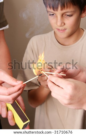 Three naughty boys playing with fire in the house - stock photo
