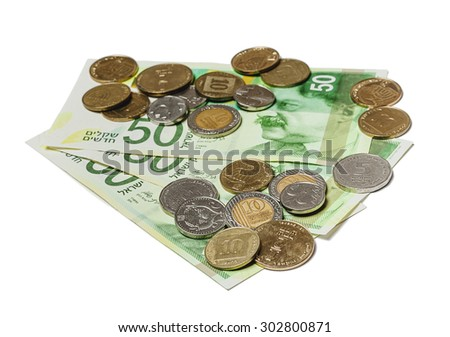 Three new 50 New Israeli Shekel bills with various israeli coins scattered on them. - stock photo
