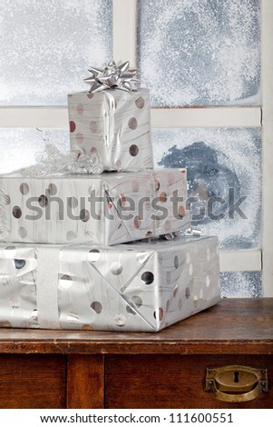 three new year presents in box on commode - stock photo