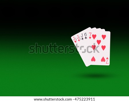 Three of a Kind playing cards on the poker table. casino concept