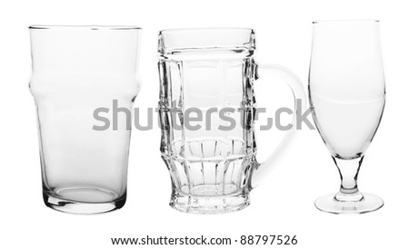 three of empty beer glasses isolated on white - stock photo