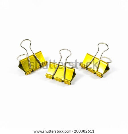 three of gold color binder clips isolated on white background - stock photo