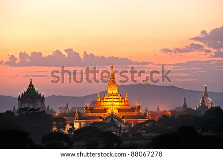 Three of the most beautiful temple of bagan after sunset, The Ananda Pahto, The Gawdawpalin Pahto and the ThatbyinnyuPlain of Bagan, Myanmar. - stock photo