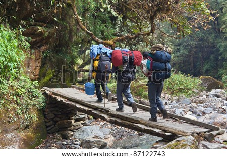 Three of tourists are on a path to Annapurna - Nepal Himalayas