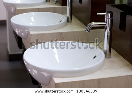 Three of wash basin in the rest room - stock photo