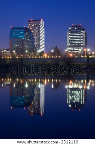 Three office buildings at night - stock photo