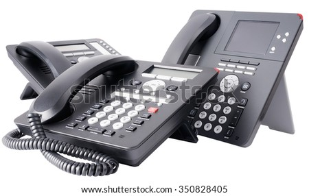 Three office digital telephone sets with LCD isolated on the white background