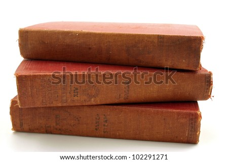 Three old books isolated on a white background - stock photo